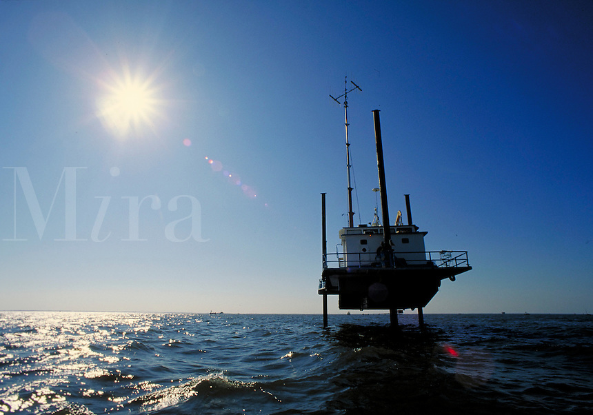 Jack-up recording vessel used in picking up data in seismic work. Louisiana, Lake Salvador.