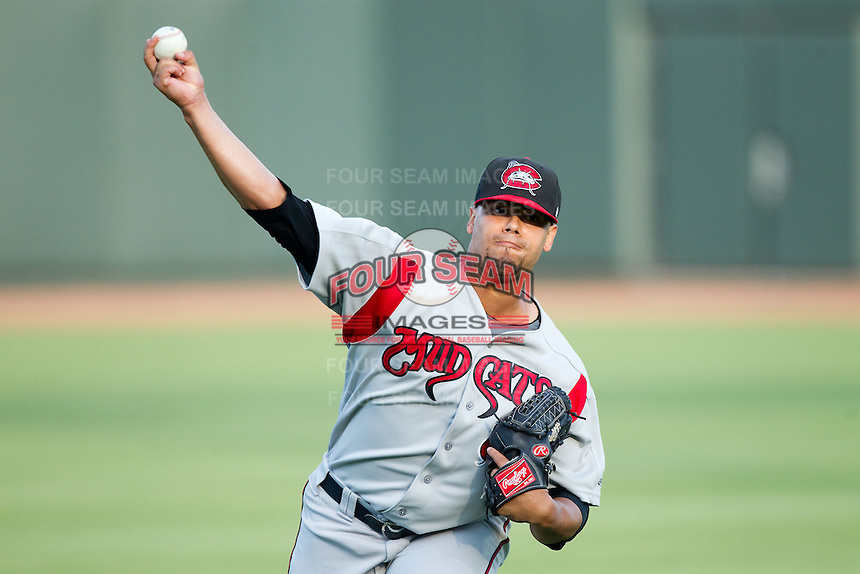 Carolina Mudcats starting pitcher Joseph Colon (29) warms up in the outfield prior to the game against the Winston-Salem Dash at BB&T Ballpark on July 25, 2013 in Winston-Salem, North Carolina.  The Mudcats defeated the Dash 5-4.  (Brian Westerholt/Four Seam Images)