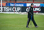 Brechin v St Johnstone....12.03.11  Scottish Cup Quarter Final.Jim Weir out on the Glebe Park pitch before kick off, forking in an attempt to drain the surface water.Picture by Graeme Hart..Copyright Perthshire Picture Agency.Tel: 01738 623350  Mobile: 07990 594431
