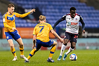 Bolton Wanderers' Arthur Gnahoua (right) competing with Mansfield Town's Harry Charsley<br /> <br /> Photographer Andrew Kearns/CameraSport<br /> <br /> The EFL Sky Bet League Two - Bolton Wanderers v Mansfield Town - Tuesday 3rd November 2020 - University of Bolton Stadium - Bolton<br /> <br /> World Copyright © 2020 CameraSport. All rights reserved. 43 Linden Ave. Countesthorpe. Leicester. England. LE8 5PG - Tel: +44 (0) 116 277 4147 - admin@camerasport.com - www.camerasport.com