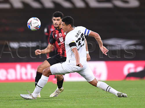 31st October 2020; Vitality Stadium, Bournemouth, Dorset, England; English Football League Championship Football, Bournemouth Athletic versus Derby County; Dominic Solanke of Bournemouth plays the ball forward under pressure from Curtis Davies of Derby County