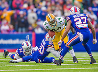 14 December 2014: Green Bay Packers running back James Starks rushes for a 4-yard gain to midfield in the first quarter against the Buffalo Bills at Ralph Wilson Stadium in Orchard Park, NY. The Bills defeated the Packers 21-13, snapping the Packers' 5-game winning streak and keeping the Bills' 2014 playoff hopes alive. Mandatory Credit: Ed Wolfstein Photo *** RAW (NEF) Image File Available ***