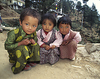 """Three young girls are dressed in their finest holiday chubas, traditional Tibetan dresses, for the upcoming Losar new years celebrations in Dharamsala, India. Since 1959 thousands of Tibetans have now raised their families in the exiled Tibetan community of Dharamsala, home to the Dalai Lama. As the older refugee generation passes on, the next find themselves hoping for the freedom of a land they have never seen. Meanwhile, Tibetan refugees strive to assimilate into the modern twenty-first century while maintaining their Tibetan identity. While some Tibetans have opted to become citizens of another society, most continue to live in limbo as guests of other nations. The question lingers, how does a culture survive without a country?<br /> """"Our aim is to educate our children as best we can to integrate with the rest of the modern world as well as maintain their traditional background,"""" says Tsering Dhondup of the S.O.S Children's school. """"We feel it's important to raise them in a Tibetan environment and for them to grow up with a sense of identity in relation to their own culture."""""""