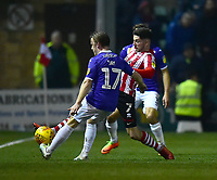 Lincoln City's Tom Pett clears under pressure from Exeter City's Matt Jay<br /> <br /> Photographer Andrew Vaughan/CameraSport<br /> <br /> The EFL Sky Bet League Two - Lincoln City v Exeter City - Tuesday 26th February 2019 - Sincil Bank - Lincoln<br /> <br /> World Copyright © 2019 CameraSport. All rights reserved. 43 Linden Ave. Countesthorpe. Leicester. England. LE8 5PG - Tel: +44 (0) 116 277 4147 - admin@camerasport.com - www.camerasport.com