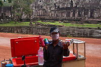 A local Khmer vendor selling water and soft drinks near he popular Bayon temple ruins. Cambodia