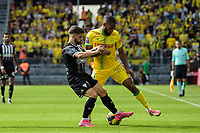 19th September  2021; Angers, Pays de la Loire, France; French League 1 football Angers versus Nantes;  Jimmy Cabot of Angers is challenged by Randal KOLO MUANI
