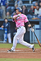 Asheville Tourists shortstop Pat Valaika #16 swings at a pitch during a game against the  Lexington Legends at McCormick Field on May 16, 2014 in Asheville, North Carolina. The Tourists defeated the Legends 11-1. (Tony Farlow/Four Seam Images)