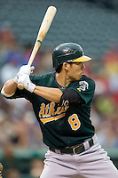 Oakland Athletics catcher Kurt Suzuki (8) at bat against the Texas Rangers in American League baseball on May 11, 2011 at the Rangers Ballpark in Arlington, Texas. (Photo by Andrew Woolley / Four Seam Images)