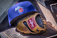 Iowa Cubs glove and hat sit on the dugout steps during a game against the Oklahoma City Dodgers at Chickasaw Bricktown Ballpark on April 9, 2016 in Oklahoma City, Oklahoma.  Oklahoma City defeated Iowa 12-1 (William Purnell/Four Seam Images)