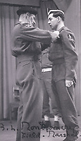 BNPS.co.uk (01202) 558833<br /> Pic: TankMuseum/BNPS<br /> <br /> Bill Bellamy receiving his Military Cross from Montgomery.<br /> <br /> <br /> A delicate china doll that served as the lucky mascot for a British tank crew and miraculously survived the war in one piece has been unearthed by a museum. <br /> <br /> The small doll, called Little Audrey, had been given to Lionel 'Bill' Bellamy by his then girlfriend Audrey before he set out for Normandy in 1944. with the Royal Armoured Corps.<br /> <br /> She was adopted by the troop and was attached to Bellamy's Cromwell tank's searchlight to the right of the turret and she became a good luck charm – and they needed her.<br /> <br /> Little Audrey remained with the men as they fought through France, Belgium, Holland and Germany. She is now going on display at the Tank Museum at Bovington, Dorset.