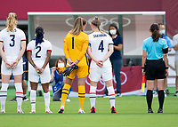 TOKYO, JAPAN - JULY 21: Alyssa Naeher #1 and Becky Sauerbrunn #4 of the USWNT stand for introductions before a game between Sweden and USWNT at Tokyo Stadium on July 21, 2021 in Tokyo, Japan.
