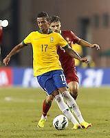 Brazil midfielder Luiz Gustavo (17) dribbles under pressure. In an international friendly, Brazil (yellow/blue) defeated Portugal (red), 3-1, at Gillette Stadium on September 10, 2013.