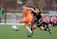 Collette McCallum (14) dribbles the ball ahead of Tina DiMartino (5). FC Gold Pride defeated Sky Blue FC 1-0 at Buck Shaw Stadium in Santa Clara, California on May 3, 2009.