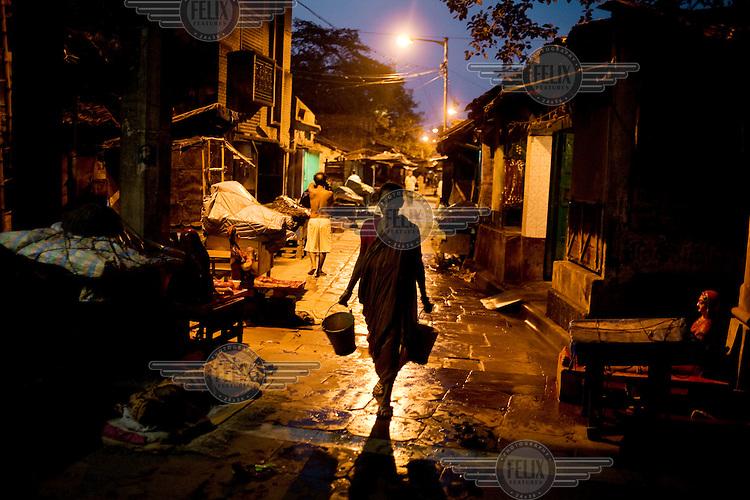 A woman walks down a street in Calcutta.