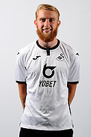 Oli McBurnie of Swansea City poses for a head shot at Fairwood Training Ground in Swansea, Wales, UK. Thursday 18, July 2019