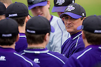 High Point Panthers assistant coach Bryan Peters talks to the team between innings of their game against the North Carolina A&T Aggies at War Memorial Stadium March 16, 2010, in Greensboro, North Carolina.  Photo by Brian Westerholt / Four Seam Images
