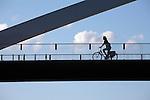Netherlands, Province Limburg, Maastricht: Cyclist on a bridge crossing the River Maas