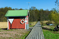 Säppi Island Lighthouse is approached from its harbour by a boardwalk which tranverses marshes and surrounding forests -Gulf of Bothnia southwest of Pori, Finland.