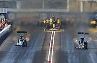 Feb. 23, 2013; Chandler, AZ, USA; NHRA top fuel dragster driver Mike Strasburg (left) races alongside Spencer Massey during qualifying for the Arizona Nationals at Firebird International Raceway. Mandatory Credit: Mark J. Rebilas-