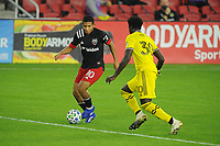 WASHINGTON, DC - OCTOBER 28: Edison Flores #10 of D.C. United battles for the ball with Aboubacar Keita #30 of Columbus Crew SC during a game between Columbus Crew and D.C. United at Audi Field on October 28, 2020 in Washington, DC.