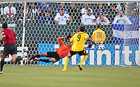 CARSON, CA – June 6, 2011: Greneda goalie Shemel Louison (30) dives to attempt to make a save from Jamaican player Ryan Johnson (9) during the match between Grenada and Jamaica at the Home Depot Center in Carson, California. Final score Jamaica 4 and Grenada 0.