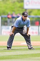 Umpire Mike Cascioppo handles the calls on the bases during the South Atlantic League game between the Hagerstown Suns and the Rome Braves at State Mutual Stadium on May 2, 2011 in Rome, Georgia.   Photo by Brian Westerholt / Four Seam Images