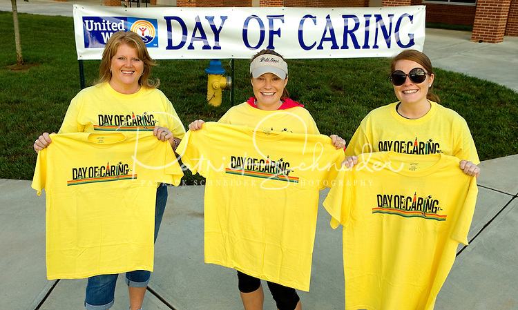 """Community Social Responsibility / CSR event photography of the United Way's annual Day of Caring event, which took place September 14, 2013 across the Mooresville and Lake Norman area.  """"Day of Caring is a great way for our community to show how much they care about our local neighbors in need,"""" Linda Beck, United Way community director for Mooresville/Lake Norman, said in a statement.  """"Fundraising is vital but not immediately visible – this day allows us to put a face to United Way, both in terms of those who take the time to serve, and those who gratefully benefit from the acts of service.""""<br /> Photo is part of a full event picture story by Charlotte Photographer - PatrickSchneiderPhoto.com"""