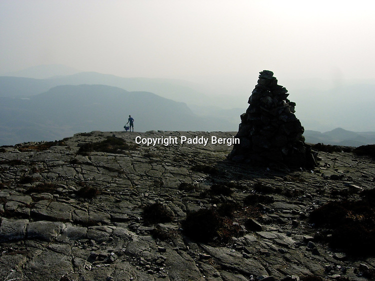 A blistering hot summers day and we were pleased to find this rock terrace to rest on. There was a stunning view and a cool breeze.<br /> <br /> Stock Photo by Paddy Bergin