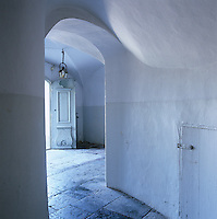 A glimpse down the hallway towards an open front door