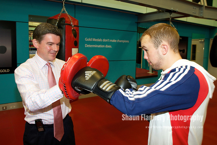 Pix: Shaun Flannery/shaunflanneryphotography.com...COPYRIGHT PICTURE>>SHAUN FLANNERY>01302-570814>>07778315553>>..20th July 2010.......GB Boxing, The English Institute of Sport, Sheffield (EIS Sheffield)..Visit of the Sports Minister Hugh Robertson..The Minister 'spars' with Iain Weaver.