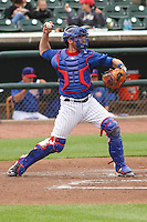 Iowa Cubs catcher Taylor Teagarden (30) throws down to second base between innings of a Pacific Coast League game against the Colorado Springs Sky Sox on May 10th, 2015 at Principal Park in Des Moines, Iowa.  Iowa defeated Colorado Springs 14-2.  (Brad Krause/Four Seam Images)