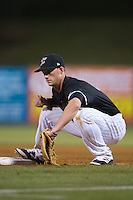 Cody Daily (31) of the Kannapolis Intimidators fields a low throw at first base during the game against the Hickory Crawdads at Kannapolis Intimidators Stadium on April 8, 2016 in Kannapolis, North Carolina.  The Crawdads defeated the Intimidators 8-2.  (Brian Westerholt/Four Seam Images)