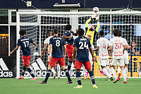 FOXBOROUGH, MA - MAY 22: Carlos Coronel #13 of New York Red Bulls saves a goal off the head of Jon Bell #22 of New England Revolution during a game between New York Red Bulls and New England Revolution at Gillette Stadium on May 22, 2021 in Foxborough, Massachusetts.