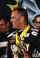 Mar 30, 2014; Las Vegas, NV, USA; NHRA top fuel driver Tony Schumacher celebrates after winning the Summitracing.com Nationals at The Strip at Las Vegas Motor Speedway. Mandatory Credit: Mark J. Rebilas-
