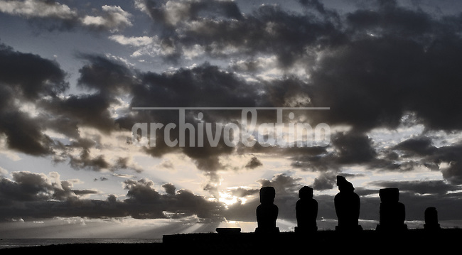 Oct, 2007, Easter Island, Chile After 5 days as a tourist, photographer Lorenzo Moscia set to discover the real life of one of the more surprising places of the World, mix of cultures between Oceania and Latin America, with a native population near extintion./ Arquelogist complex in the tahai sector. One km from the village of Hanga Roa. It was rebuild in the '60 from William Mulloy, amercian arqueologist whe died in 1976. His grave is right close to Tahai complex. Mulloy is the only foreign arqueologist who is burried on the island. Lorenzo Moscia/