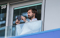 Andrea PIRLO takes shots on his phone from the directors box before the EPL - Premier League match between Chelsea and West Bromwich Albion at Stamford Bridge, London, England on 11 December 2016. Photo by Andy Rowland.