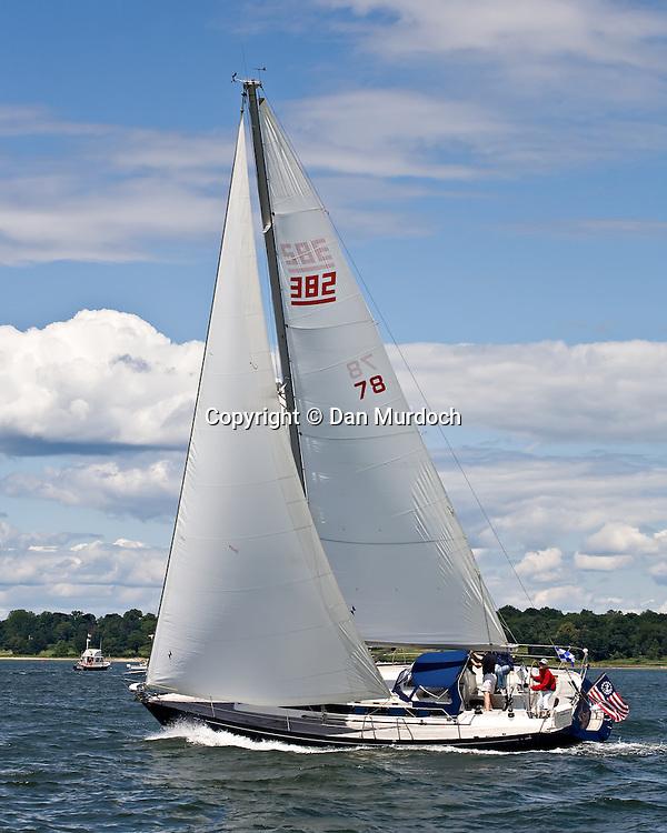 Sloop sailing close hauled under blue skys