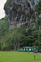 Cuba, Pinar del Rio Region, Valle de Viñales (Vinales) Area.  Rural House under a Limestone Mogote.