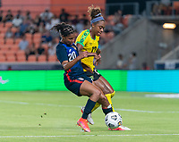 HOUSTON, TX - JUNE 13: Margaret Purce #20 of the USWNT fights for the ball with Allyson Swaby #17 of Jamaica during a game between Jamaica and USWNT at BBVA Stadium on June 13, 2021 in Houston, Texas.