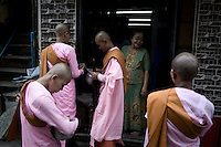 Nuns collecting food on the streets of Rangoon.