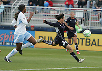 Lisa De Vanna (right) of the Washington Freedom  beats Chioma Igwe #12 of the Chicago Red Stars to the ball during a WPS match at Maryland Soccerplex on April 11 2009, in Boyd's, Maryland. The game ended in a 1-1 tie