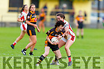 Austin Stacks Marina Barry been tackled by Mary Collins of Rathmore in the Kerry LGFA Championship Football Semi Final