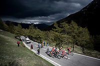 grupetto up the Colle San Carlo (Cat1/1921m/10.1km/9.8%) under a menacing sky<br /> <br /> Stage 14: Saint Vincent to Courmayeur/Skyway Monte Bianco (131km)<br /> 102nd Giro d'Italia 2019<br /> <br /> ©kramon