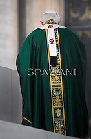 """Pope Benedict XVI during Holy Mass for the opening of the Synod of Bishops and proclamation of St John of Avila and St Hildegard of Bingen as """"Doctors of the Church  in St. Peter square at the Vatican, 7 October, 2012"""