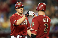 Arizona Diamondbacks outfielder A.J. Pollock #11 is greeted by Aaron Hill #2 after hitting a home run during a National League regular season game against the Colorado Rockies at Chase Field on October 3, 2012 in Phoenix, Arizona. Colorado defeated Arizona 2-1. (Mike Janes/Four Seam Images)