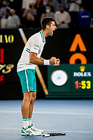 21st February 2021, Melbourne, Victoria, Australia; Novak Djokovic of Serbia celebrates after winning his match during the Men's Singles Final of the 2021 Australian Open on February 21 2021, at Melbourne Park in Melbourne, Australia.
