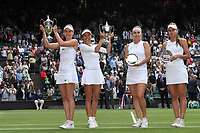 10th July 2021. Wilmbledon, SW London England. Wimbledon Tennis Championships 2021, Ladies doubles final;  Su-Wei Hsieh TPE and Elise Mertens Belgium pose with their winners trophies next to finalists Elena Vesnina and Veronika Kudermetova of Russia