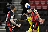 Adebayo Akinfenwaof Wycombe Wanderers  and Steve Cook of AFC Bournemouth vie for a header during AFC Bournemouth vs Wycombe Wanderers, Sky Bet EFL Championship Football at the Vitality Stadium on 15th December 2020