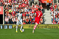 Sun 06 October 2013 Pictured:Chico Flores tries to get the ball past Rickie Lambert of Southampton Re: Barclays Premier League Southampton FC  v Swansea City FC  at St.Mary's Stadium, Southampton