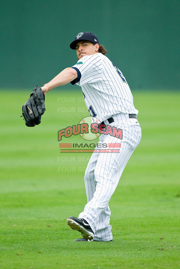 Charlotte Knights starting pitcher Zach Stewart (21) warms up in the outfield prior to the game against the Lehigh Valley IronPigs at Knights Stadium on August 6, 2013 in Fort Mill, South Carolina.  The IronPigs defeated the Knights 4-1.  (Brian Westerholt/Four Seam Images)